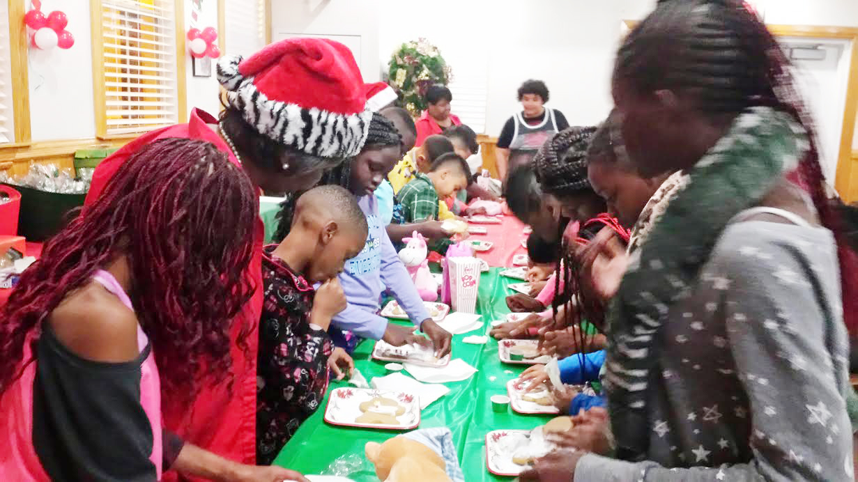 Greater Miami bring Christmas cheer to children at the Chapman Center. Each child created their very own gingerbread man with decorations and afterwards they ate the man!!! More than 40 children wore their pajamas, ate popcorn and watched movies during the celebration.